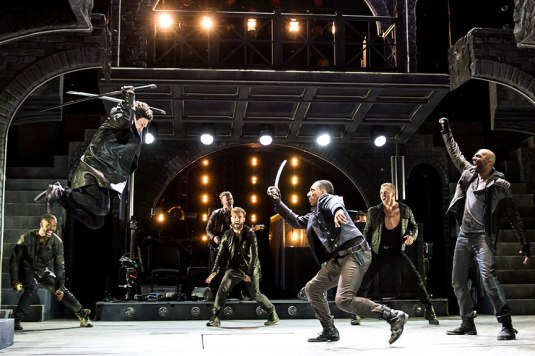 (foreground with swords, from left) Jeremy Woodard as Tybalt and  Brandon Gill as Benvolio with the cast of The Last Goodbye